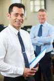 Young Businessman With Senior Mentor In Office Stock Photography