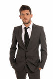 Young businessman serious hands pockets isolated. Young businessman looking serious hands in pockets isolated on white background royalty free stock photography