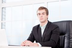 Young businessman seriously looking at camera in Stock Photography