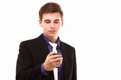 Young businessman seriously looking to the phone Royalty Free Stock Photography