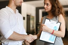 Young businessman shaking hands with female manager. stock photos