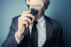 Young businessman shaving Royalty Free Stock Image