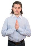 Young businessman in shirt meditates isolated Royalty Free Stock Image