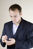 Young businessman Shocked with cellphone Royalty Free Stock Photos