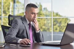 Young Businessman Shocked Royalty Free Stock Photos