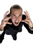 Young businessman shouting and looking upside Stock Photos