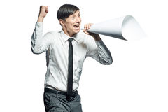 Young businessman shouting with a papers megaphone Stock Images