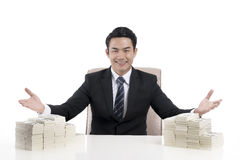 Young businessman show body language to invite with the open han. A happy young businessman show body language to invite with the open hand wide, among the huge Royalty Free Stock Photos