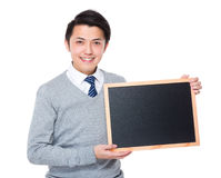 Young businessman show with chalkboard. Isolated on white background Stock Images
