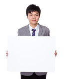 Young businessman show with white board Stock Images