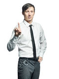Young businessman showing attention sign Royalty Free Stock Photo
