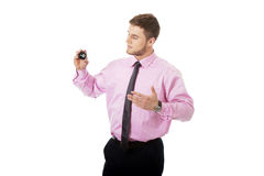 Young businessman showing billiard ball. Royalty Free Stock Images