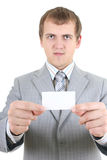 Young businessman showing a blank business card Royalty Free Stock Images