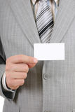 Young businessman showing a blank business card Stock Photography