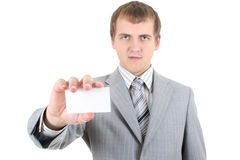 Young businessman showing a blank business card Stock Photos