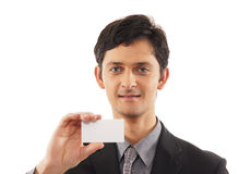 A young businessman showing a blank visit card Stock Photography