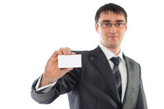 Young businessman showing a business card. Isolation image Royalty Free Stock Photo
