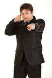 Young businessman showing contact me gesture Royalty Free Stock Photos