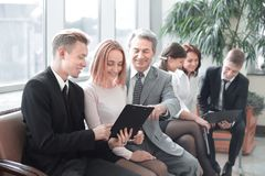 Young businessman showing a document to his colleagues. Office weekdays stock image