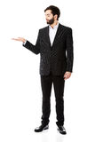 Young businessman showing empty copyspace on hand. Stock Photos