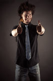 Young businessman showing finger up Stock Photos