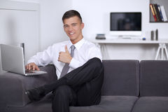 Young businessman showing hand gesture thumb up Royalty Free Stock Images