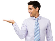 Young Businessman Showing Invisible Product Royalty Free Stock Photography