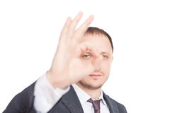 Young businessman showing symbol OK Royalty Free Stock Image