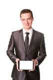 Young businessman showing a tablet pc comuter with blank screen for your sample text Royalty Free Stock Photography