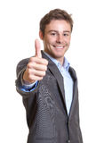 Young businessman showing thumb Stock Photo