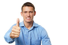 Young businessman showing thumb up Stock Photos