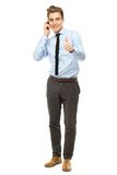 Young businessman showing thumbs up Stock Image
