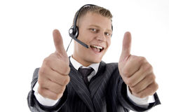 Young businessman showing thumbs up Stock Images