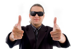 Young businessman showing thumbs up Royalty Free Stock Images
