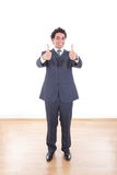Young businessman showing thumbs up with both hands stock photos