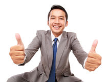 Young businessman showing thumbs up Royalty Free Stock Image