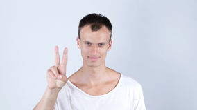 Young Businessman showing victory sign Stock Photography