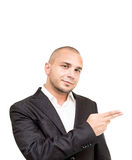 Young businessman shows something with his hand Royalty Free Stock Photos