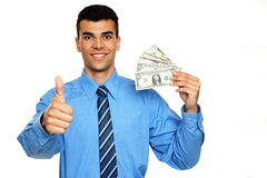 Young businessman shows you money Royalty Free Stock Images