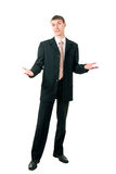Young businessman shrugging Royalty Free Stock Photography