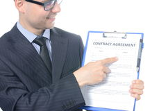 Young businessman signing a contract. Isolated on white Stock Photo