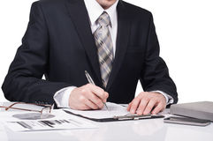 Young businessman signing a contract in office. The concept of a successful business Stock Photos