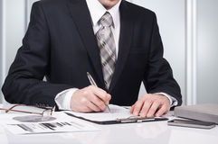 Young businessman signing a contract in office. The concept of a successful business Royalty Free Stock Images