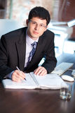 Young businessman signing a document Royalty Free Stock Images