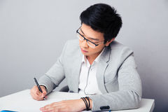 Young businessman signing document Royalty Free Stock Image