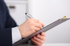 Young businessman signs contract Royalty Free Stock Photos