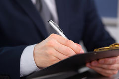 Young businessman signs contract Royalty Free Stock Photography