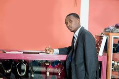 Young businessman signs a partnership royalty free stock photography