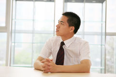 Young businessman sit in office stock photography