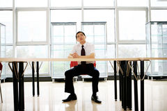 Young businessman sit in office Royalty Free Stock Images